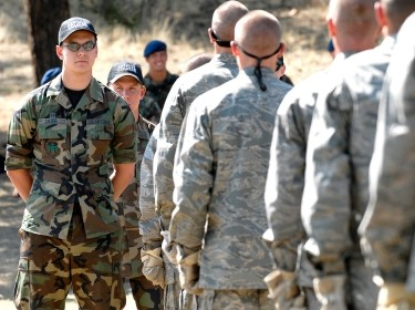 U.S. Air Force Academy Cadet 1st Class Randall Chlebek prepares basic cadets to begin the assault course during the field training portion of basic training