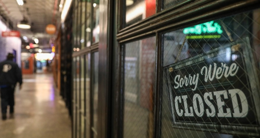 A worker cleans an empty hall in Industry City, Brooklyn, where shops have been closed due to the outbreak of the coronavirus disease (COVID-19)