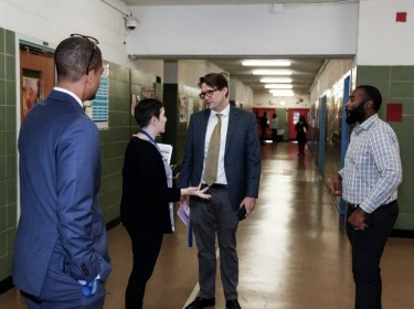 Educators talking in a school hallway, photo by Claire Holt/The Wallace Foundation