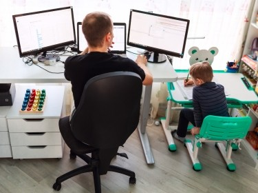Father with kid working from home during quarantine, photo by len4ik/Adobe Stock