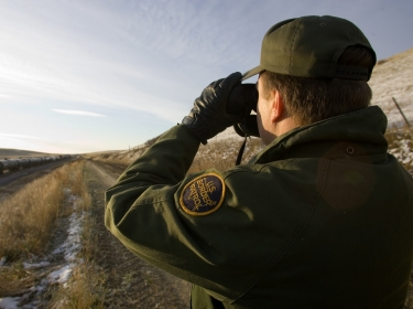 CBP Border Patrol agent scans trains passing through Montana for any illegal actives.