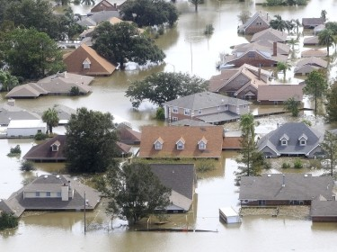 Houses are partially submerged in flood waters after a Hurricane Isaac levee breach in Braithwaite, Louisiana August 31, 2012