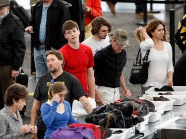Travelers line up at Denver International Airport