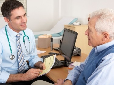 doctor speaking with senior patient