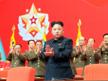 North Korean leader Kim Jong Un applauds during a meeting of security personnel of the Korean People's Army