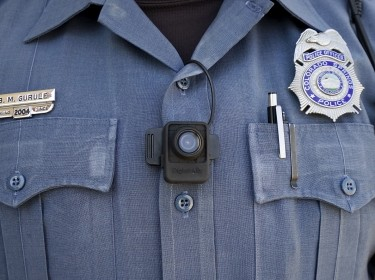 A police officer poses with a body-worn camera on his chest in Colorado Springs, April 21, 2015