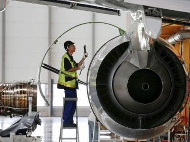 An employee checks the engine at the A320 family final assembly line at an Airbus factory in Tianjin, China, August 12, 2015
