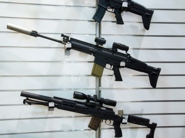 Gun wall rack with rifles, photo by artas/Getty Images