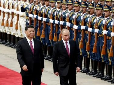 Chinese President Xi Jinping and Russian President Vladimir Putin attend a welcome ceremony outside the Great Hall of the People in Beijing, China June 8, 2018