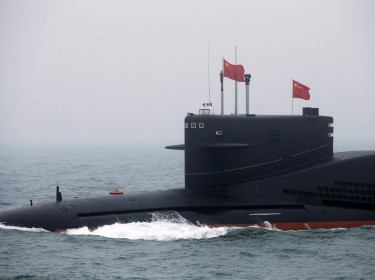 The Chinese Navy's nuclear-powered submarine Long March 11 takes part in a naval parade to mark the 70th anniversary of the founding of Chinese People's Liberation Army Navy, China, April 23, 2019, photo by Jason Lee/Reuters