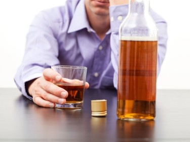Man drinking whiskey alone