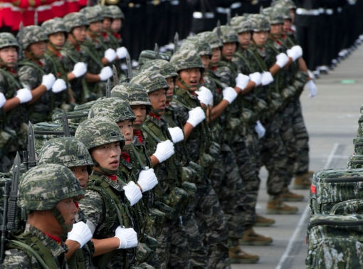 South Korean soldiers conduct a pass in review during a military parade in Seoul, South Korea