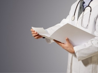 Physician reviewing file