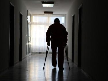 Disabled man in hospital corridor