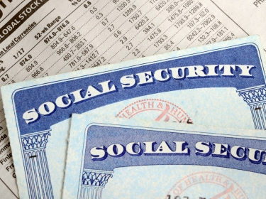 Social Security cards and investment portfolio statement