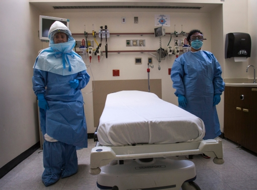 Hospital staff wear protective gear to protect them from an Ebola virus infection in the emergency department of Bellevue Hospital in Manhattan, New York, October 8, 2014